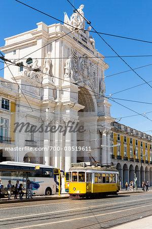 Old yellow tram in Praca do Comercio at the Rua Augusta Arch (Arco Triunfal), Baixa District, Lisbon, Portugal
