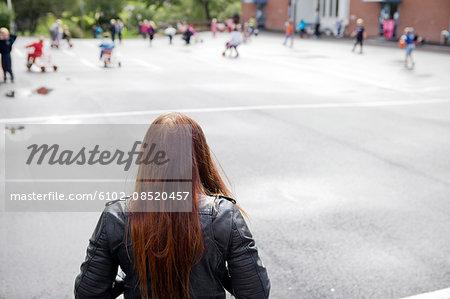 Alone girl on the school yard
