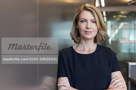 Portrait senior businesswoman with arms crossed