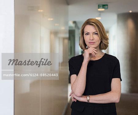 Portrait confident businesswoman in office corridor