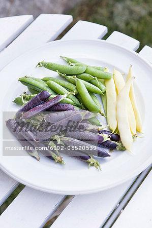 Fresh peas on plate