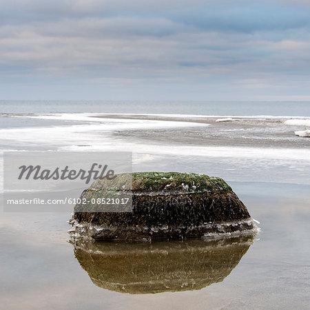Rock in calm sea