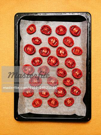 Baked tomatoes on baking tray