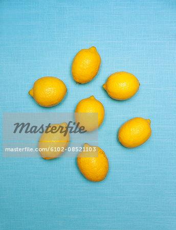 Lemons on blue background