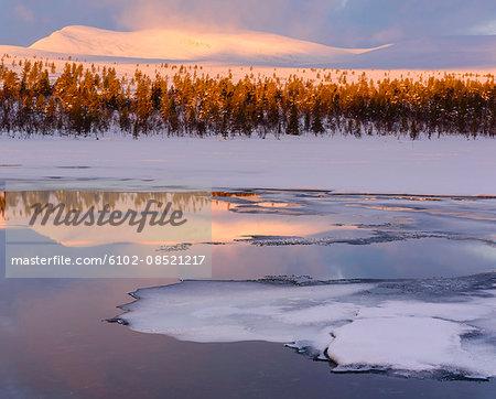Frozen sea at sunset