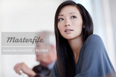Serious businesswoman looking away