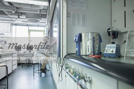Two scientist working in a pharmacy laboratory, Freiburg im Breisgau, Baden-Württemberg, Germany