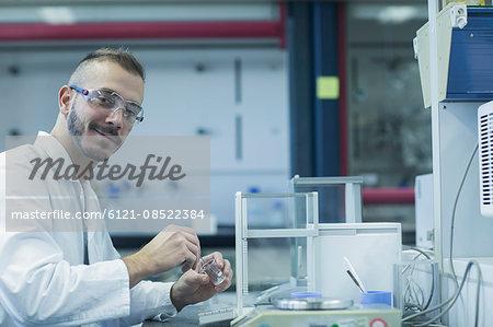 Portrait of a young male scientist working in a pharmacy laboratory, Freiburg im Breisgau, Baden-Württemberg, Germany