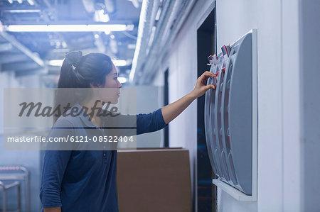 Young female engineer working in an industrial plant, Freiburg im Breisgau, Baden-Württemberg, Germany