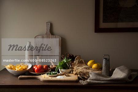 Rustic italian ingredients on wooden tabletop