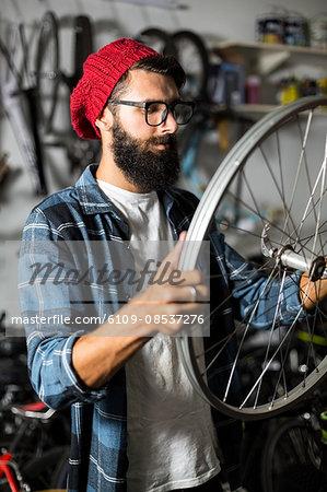 Bike mechanic checking at wheel