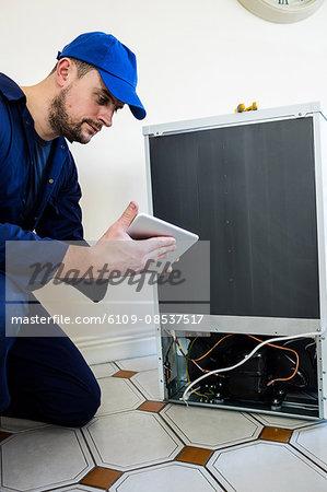 Handyman repairing a machine