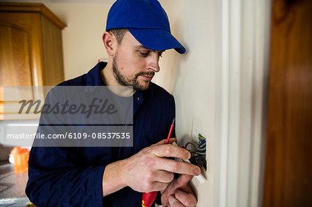 Electrician fixing a door bell