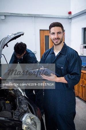 Mechanic preparing a check list