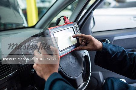 Mechanic using a diagnostic tool