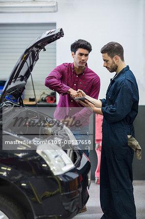 Customer shaking hands with mechanic