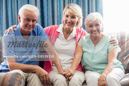 Nurse sitting between a senior couple