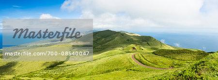 Green landscape with volcanic craters, beneath the volcanic formation of Pico da Esperanca (1052 m) mountain, Norte Grande, Sao Jorge Island, Azores, Portugal