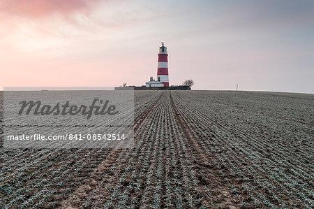 Sunrise at Happisburgh Lighthouse on a frosty morning, Happisburgh, Norfolk, England, United Kingdom, Europe