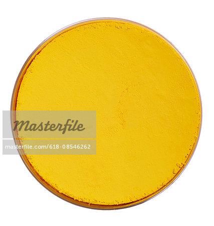 A close up image of yellow make up powder