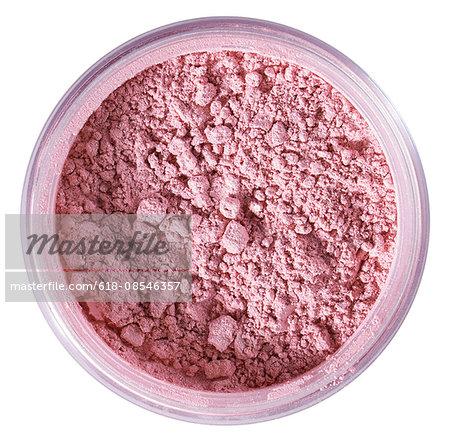 a beauty product shot of pink make up powder