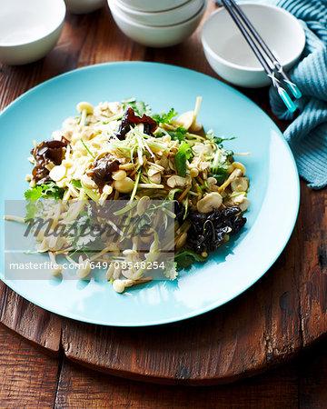 High angle view of mushroom and celery salad on blue plate