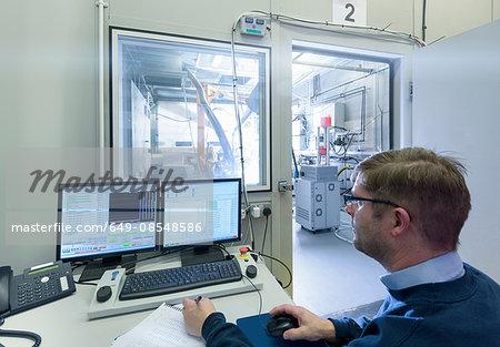 Engineer in control room of engine testing bay