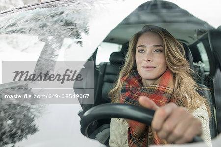 Woman behind wheel in winter