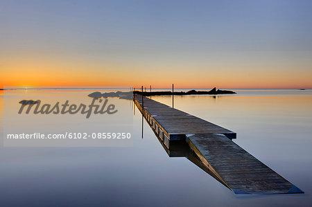 Jetty at sunrise, Sweden