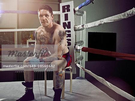 Boxer sitting in corner of ring