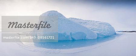 Snowy glacier in arctic water