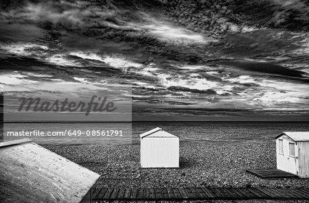 Huts on rocky beach
