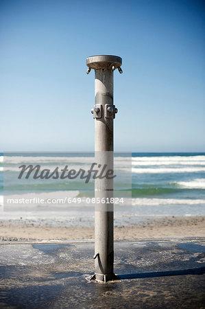Pole in concrete on beach
