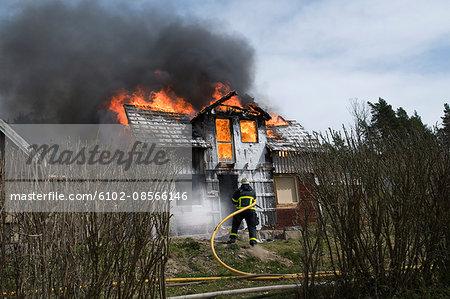 Fireman extinguishing fire