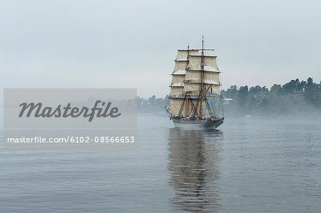 Tall ship on foggy sea
