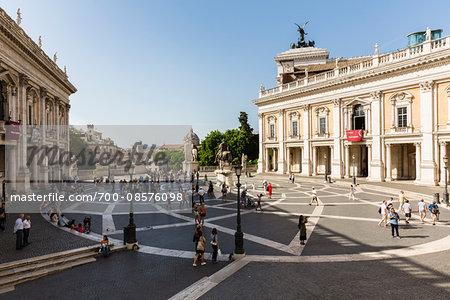 Palazzo dei Conservatori and the Statues of Castor and Pollux, Musei Capitolini, Piazza del Campidoglio with the Monument to Vittorio Emanuele II in the background, Capitoline Hill, Rome, Italy