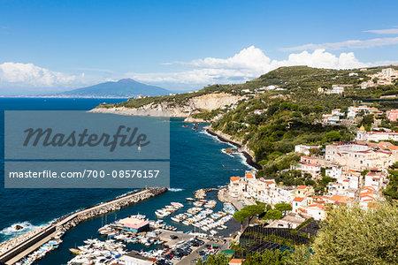 Elevated view of Marina della Lobra with Mount Vesuvius in the background, Massa Lubrense, Province of Naples, Sorrento Peninsula, Campania, Italy