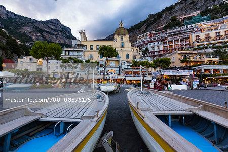 Boats on the beach in front of the Church of Santa Maria Assunta at dusk, Positano, Amalfi Coast, Province of Salerno, Campania, Italy