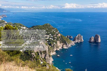 Elevated view of Capri and the Marina Piccola with the Faraglioni cliffs, the Sorrento Peninsula in the distance, Tyrrhenian Sea, Gulf of Naples, Campania, Italy
