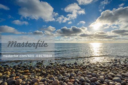 Sky with Clouds and Sun over pebble Beach, Summer, Sealands Odde, Odsherred, Baltic Sea, Zealand, Denmark