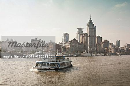 Ferryboat on urban river