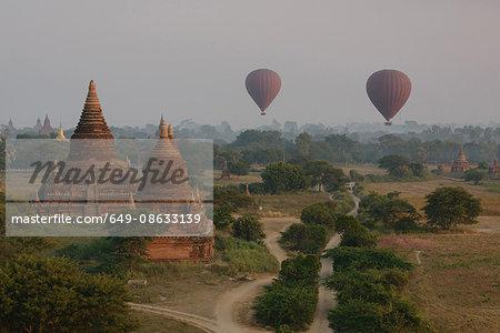 Hot air balloons and temples at sunrise, Bagan, Burma