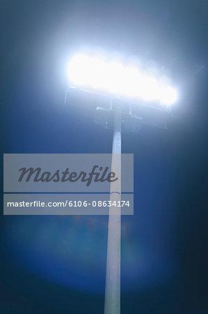 Stadium lights brightly shining at night