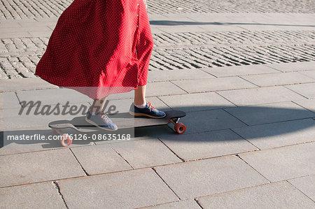 Sweden, Stockholm, Kungstradgarden, Teenage girl (16-17) on longboard