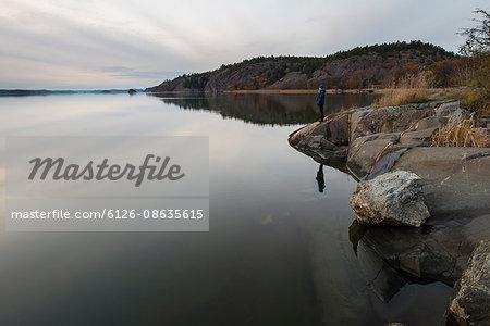 Sweden, Ostergotland, Woman looking at view at Slatbaken lake
