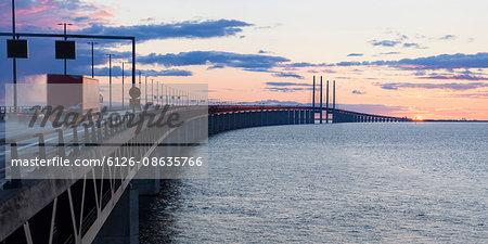 Sweden, Skane, Malmo, Oresund Bridge at  sunset
