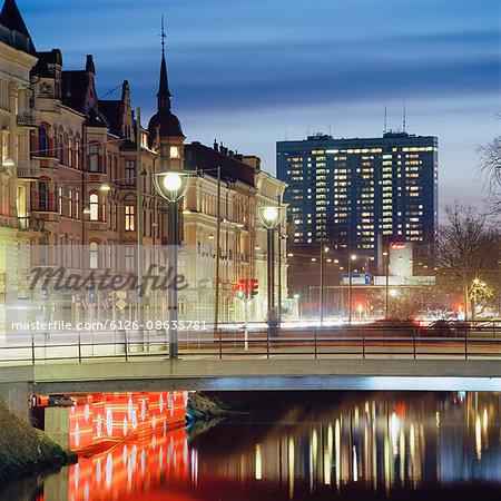 Sweden, Skane, Malmo, Illuminated bridge at dusk