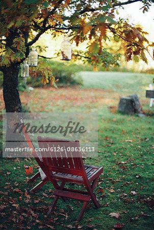 Sweden, Vastmanland, Chairs in backyard