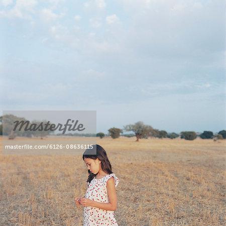 Portugal, Alentejo, Castro Verde, Portrait of girl (6-7) in field