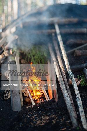 Sweden, Vastmanland, Bergslagen, Burning fire and logs in kiln